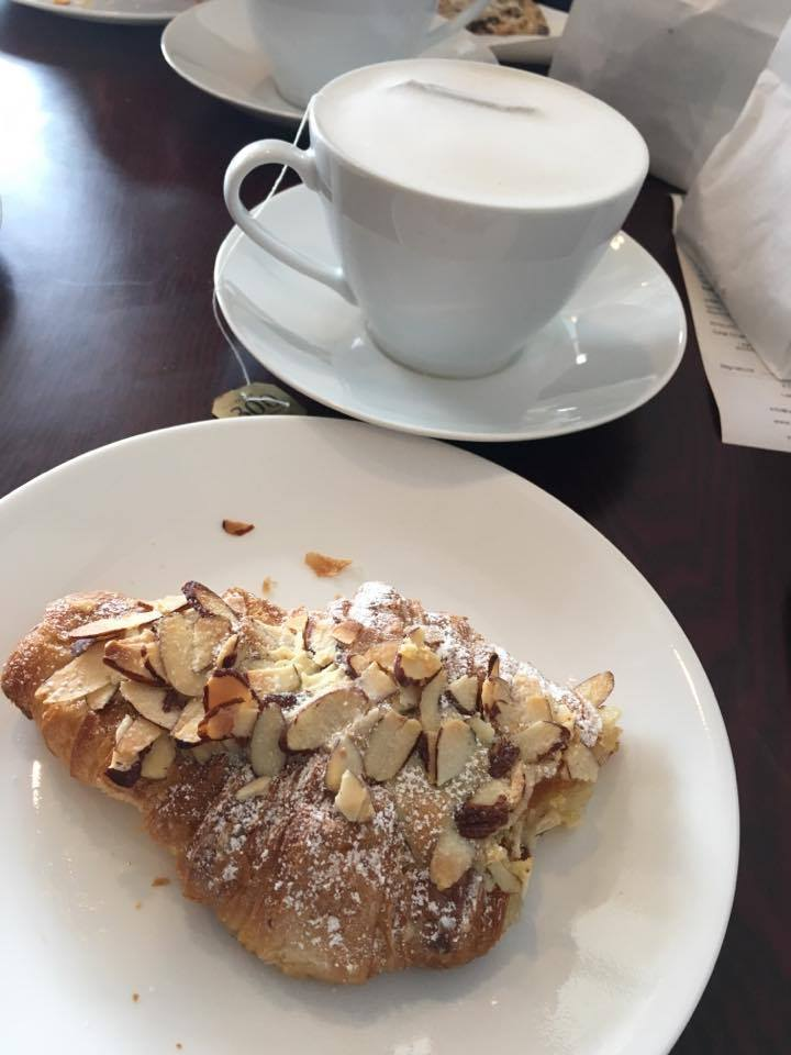 Almond croissant and earl grey tea at Layered Cake Patisserie in Leesburg, Virginia