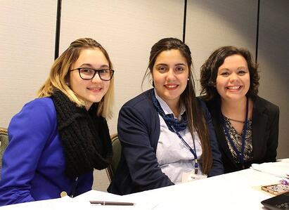 Patrick Henry College (PHC) student Julianne Owens works with National Model United Nations (NMUN) delegates from other colleges