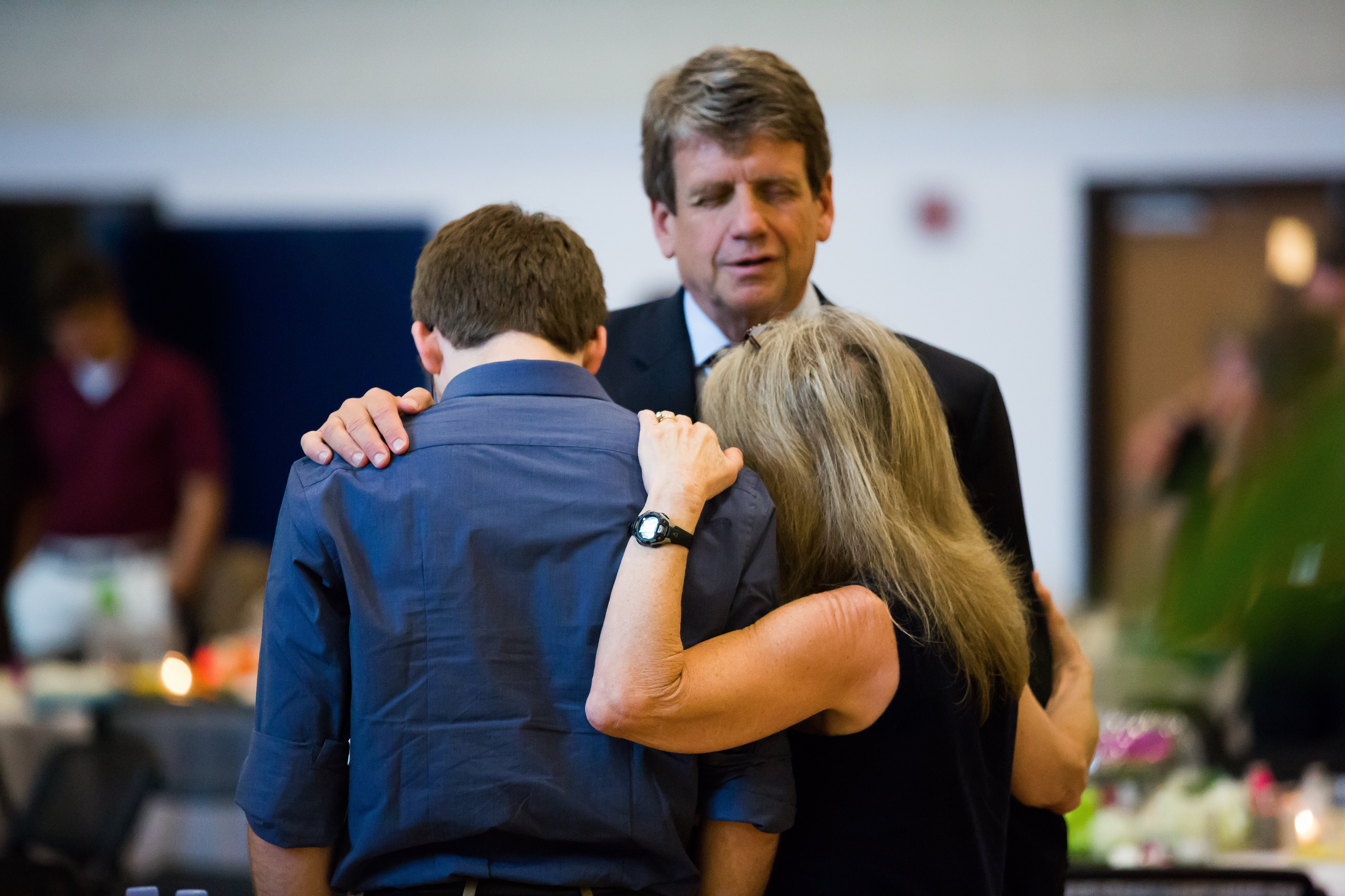 Orientation_2015_Michael_Farris_praying_with_family_chancellor_1.jpg