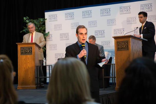 Patrick Henry College (PHC) Millienium Society President introduces Mark Krikorian and Alex Nowrasteh before their debate on immigration and national security at PHC