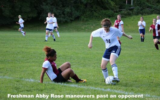 Freshman Abby Rose maneuvers past an opponent