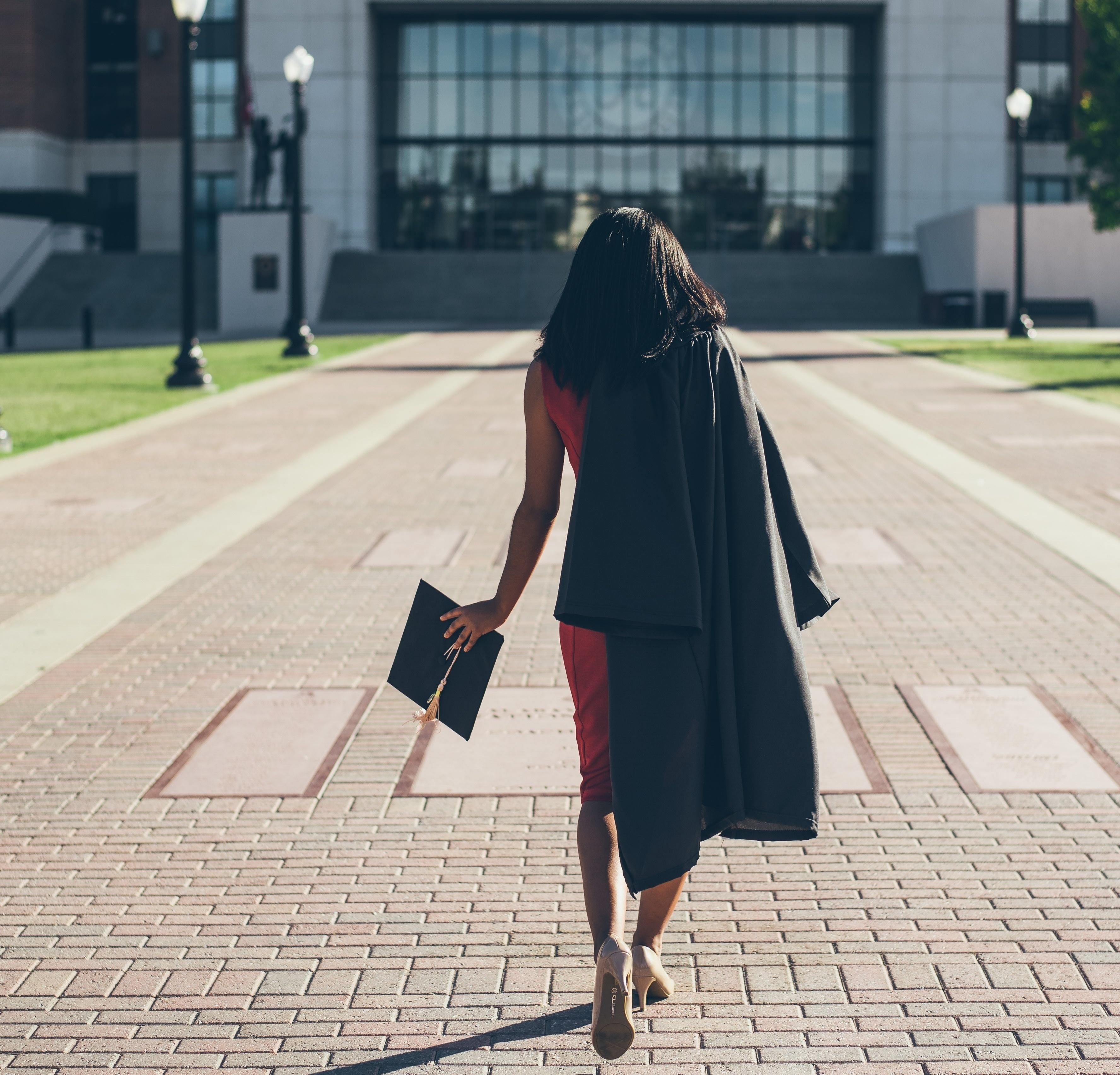 Recent graduate walking away