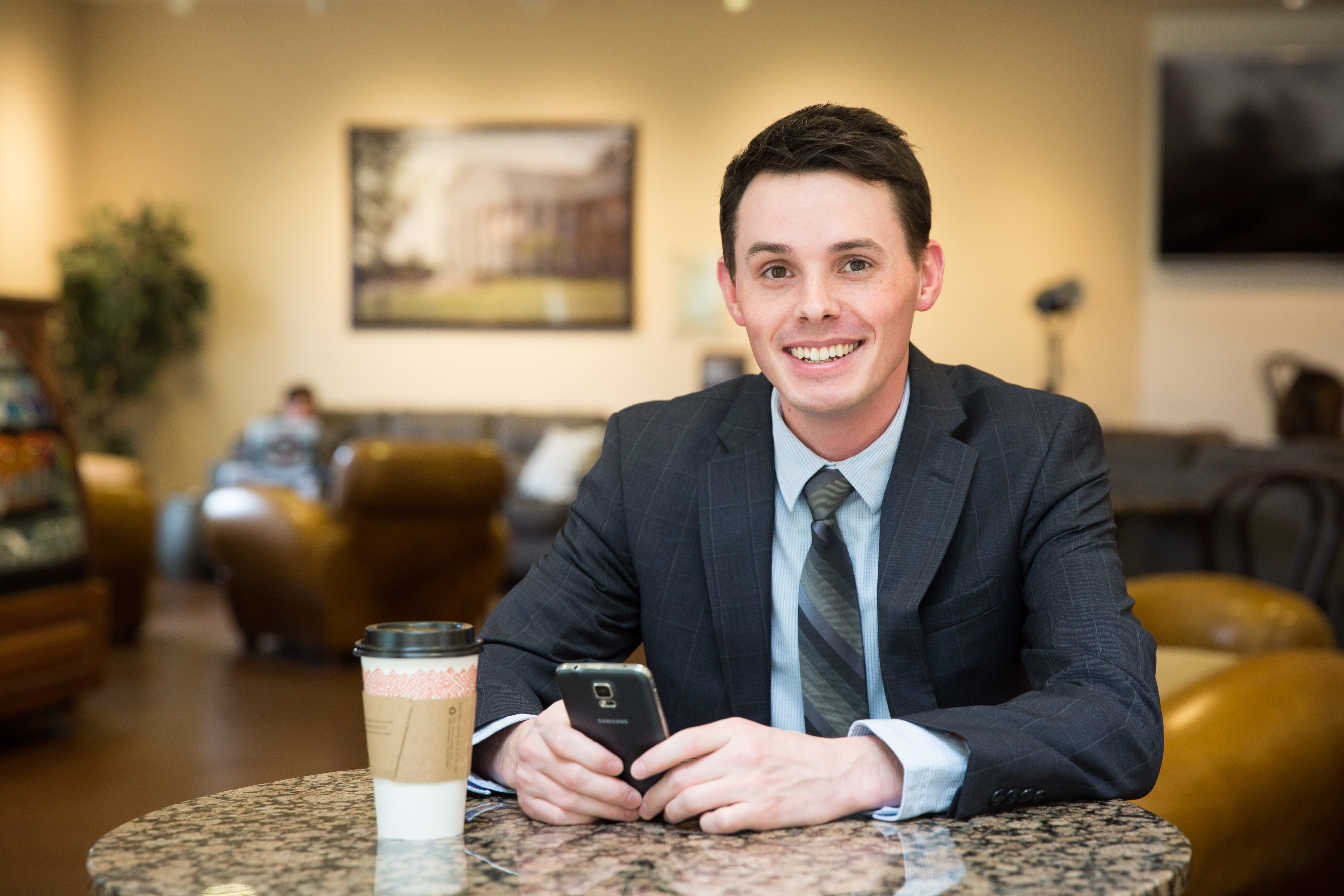 Patrick Henry College Student in the Peet's Coffee Shop on campus